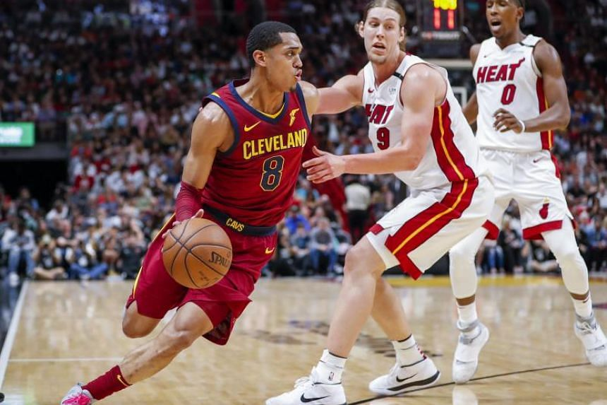 Cleveland Cavaliers guard Jordan Clarkson (left) drives against Miami Heat forward Kelly Olynyk (centre) and Miami Heat forward Josh Richardson (right) during the second half of the NBA basketball game between the Cleveland Cavaliers and the Miami He