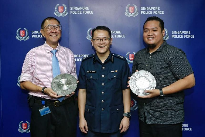 Assistant Commissioner of Police and Commander of Bedok Police Division Tan Tin Wee (centre) with Public Spiritedness Award recipients dental surgeon Michael Lim (left), 62, and SMRT staff Muhammad Noh Abdul Sukor, 34.