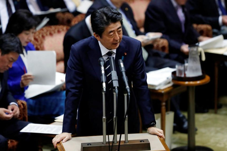 Japan's Prime Minister Shinzo Abe answers a question during an upper house parliamentary session in Tokyo, Japan, on March 28, 2018.