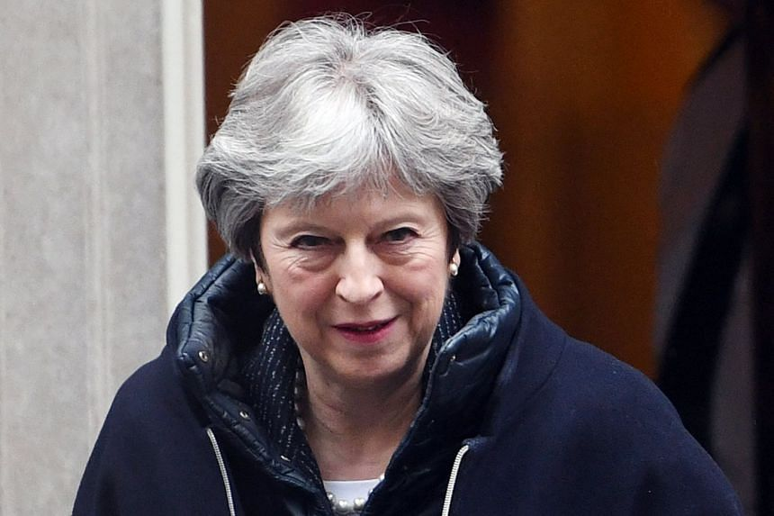 Theresa May leaving 10 Downing Street to attend Prime Minister's Questions at the Houses of Parliament.