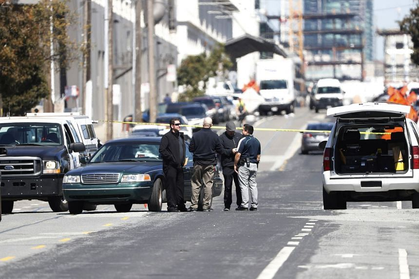 Police officers are seen at the scene of a hit-and-run incident in San Francisco.