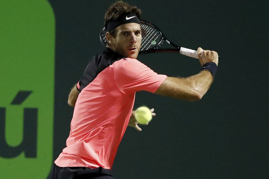 Juan Martin del Potro of Argentina hitting a backhand against Milos Raonic of Canada on day nine of the Miami Open at Tennis Centre at Crandon Park.