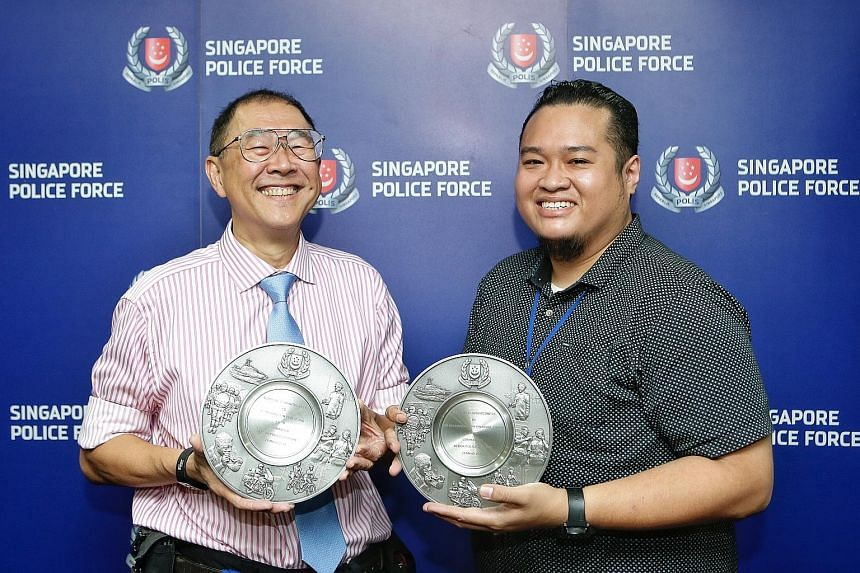 Dr Michael Lim (left) and Mr Mohammed Noh Abdul Sukor were among the eight who got the Public Spiritedness Award from the Bedok police.