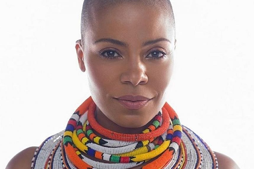 Actress Sanaa Lathan (left), who shaved her head for the upcoming film Nappily Ever After, has defended herself with a tweet.