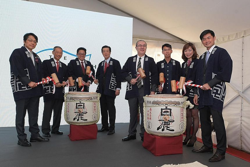 An artist's impression of The Woodleigh Residences, which offers condominium units ranging from two-to four-bedders. At The Woodleigh Residences and Mall ground-breaking ceremony were (from left) Kajima Corporation senior managing officer Keisuke Kos