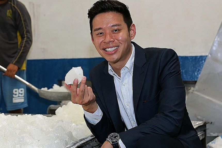 Mr John Cheng (left), director of the Cheng Yew Heng Candy Factory, with rock sugar manufactured by the family business. The factory also produces the distinctive orange-coloured sugar (above) served with putu mayam. The factory will open its doors t