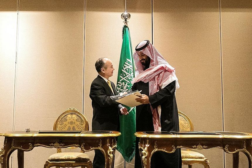 SoftBank chief executive Masayoshi Son and Saudi Crown Prince Mohammed bin Salman after signing their agreement on a solar power project - expected to have the capacity to produce up to 200 gigawatts by 2030 - on Tuesday.