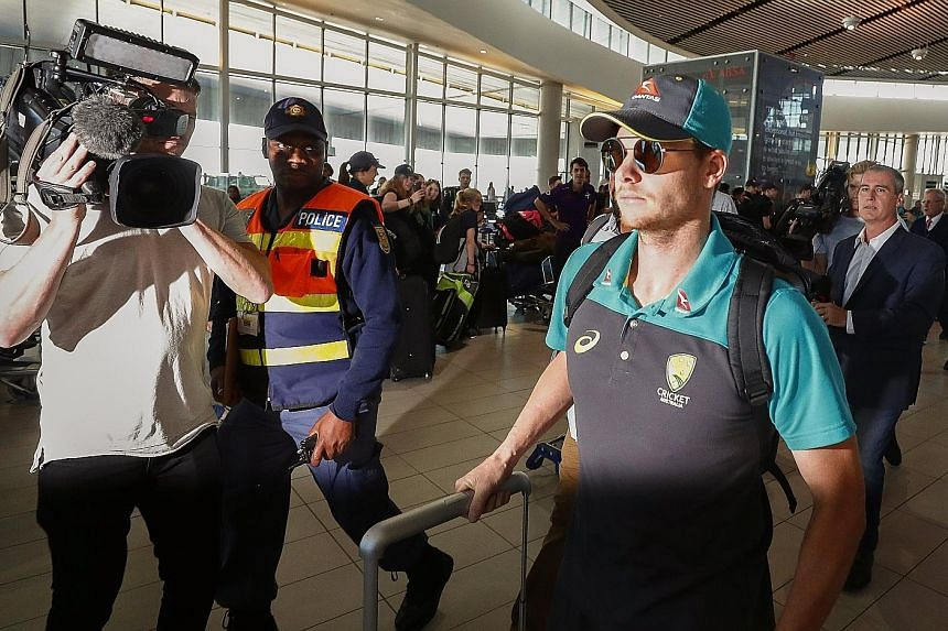 Australian Steve Smith, who has been stood down from his captaincy role for a minimum two-year period, departs from Cape Town International Airport on Tuesday.