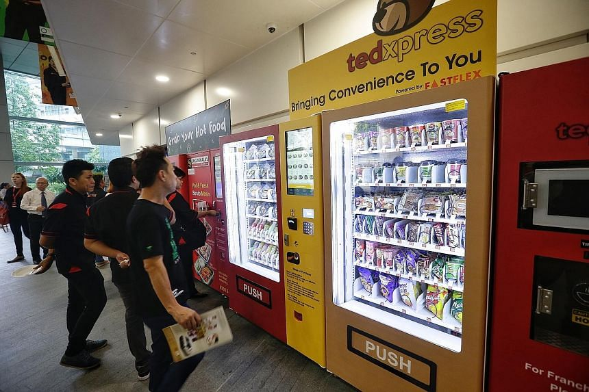 Food vending machines at ITE College East. Students in the development stage of the project will be involved in creating recipes and new food vending technologies which may be introduced to the market.
