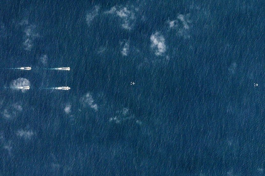 A satellite image from Monday showing Chinese navy ships south of Hainan island in the South China Sea.