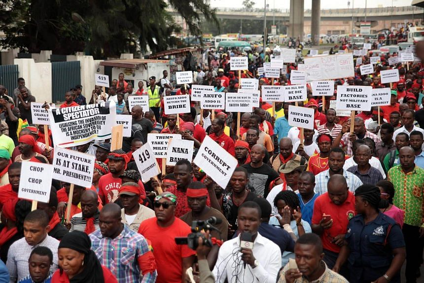 A crowd of protestors holding placards while demonstrating against the expansion of the country's defence cooperation with the United States in the streets of Accra, Ghana on March 28, 2018.