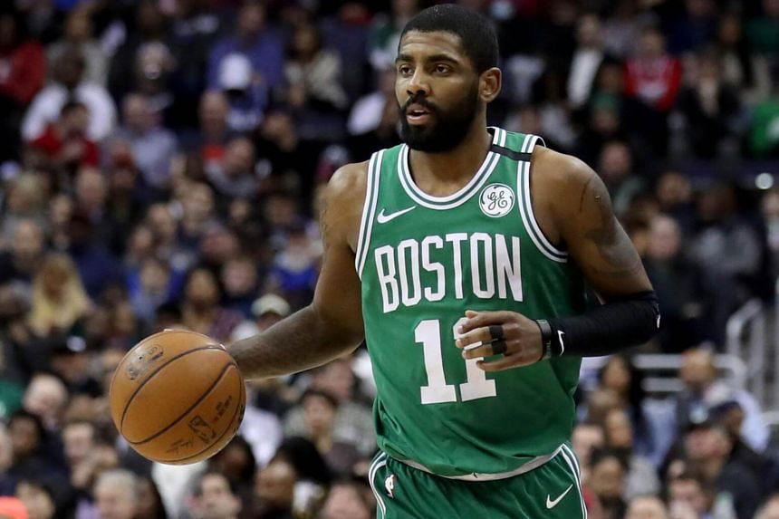 Kyrie Irving of the Boston Celtics dribbles the ball against the Washington Wizards at Capital One Arena in Washington, on Feb 8, 2018.
