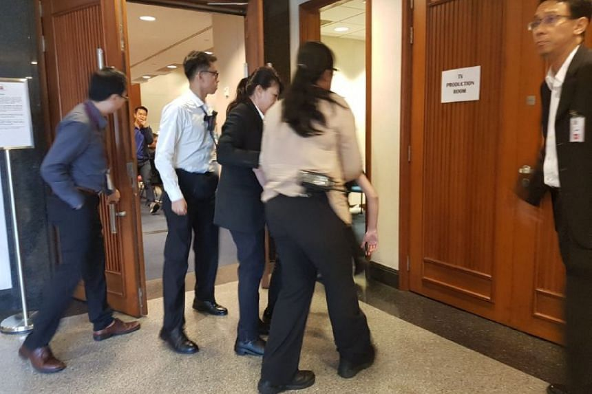 Blogger Han Hui Hui was carried out of the hearing room after she refused to leave her seat and insisted she did not want to miss the hearing.