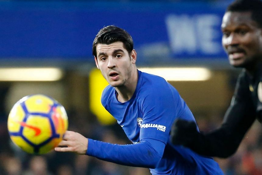 Morata eyes the ball in a match against Leicester City.