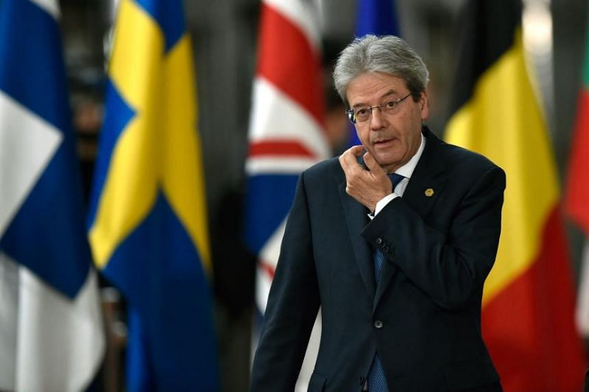 Italy's Prime minister Paolo Gentiloni arrives on the first day of a summit of European Union (EU) leaders at the EU headquarters in Brussels, on March 22, 2018.