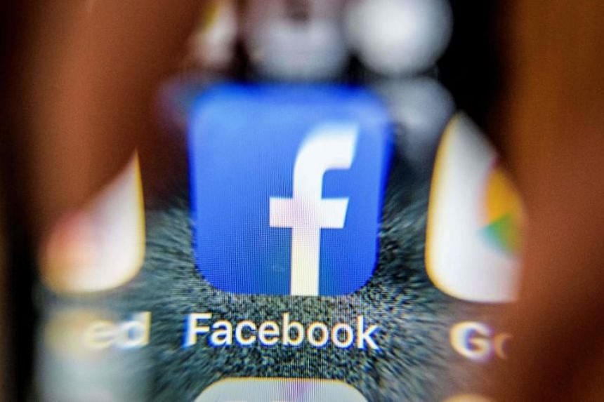 The icon for the social networking app Facebook on a smart phone screen in Moscow on March 28, 2018.
