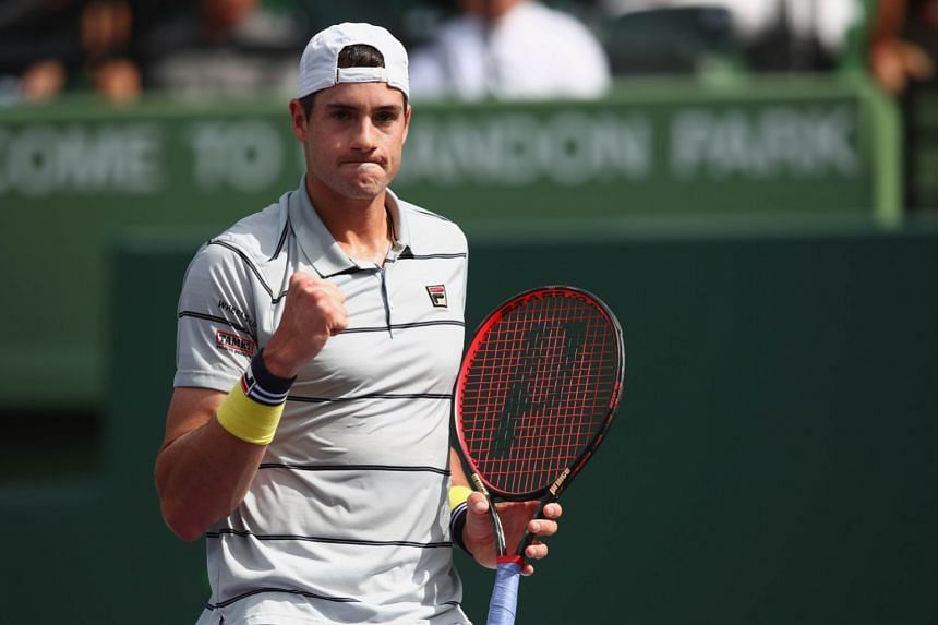 John Isner celebrating a point against Chung Hyeon of South Korea.
