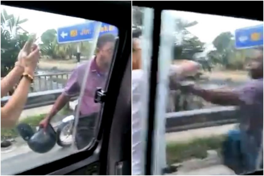 The bus driver was seen taking off his motorcycle helmet, before thrusting it towards one of the men, who had started filming the incident on his mobile phone.