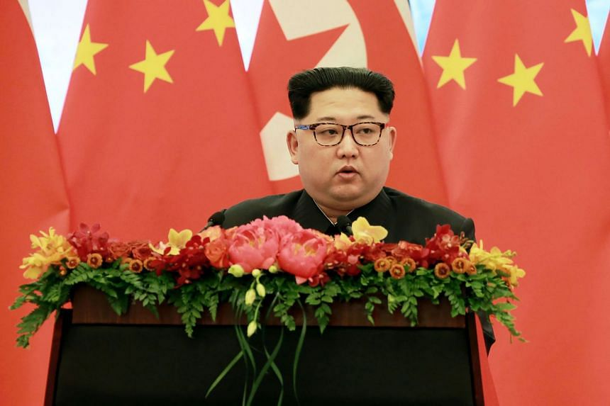 North Korean leader Kim Jong Un delivering a speech at the Great Hall of the People in Beijing.