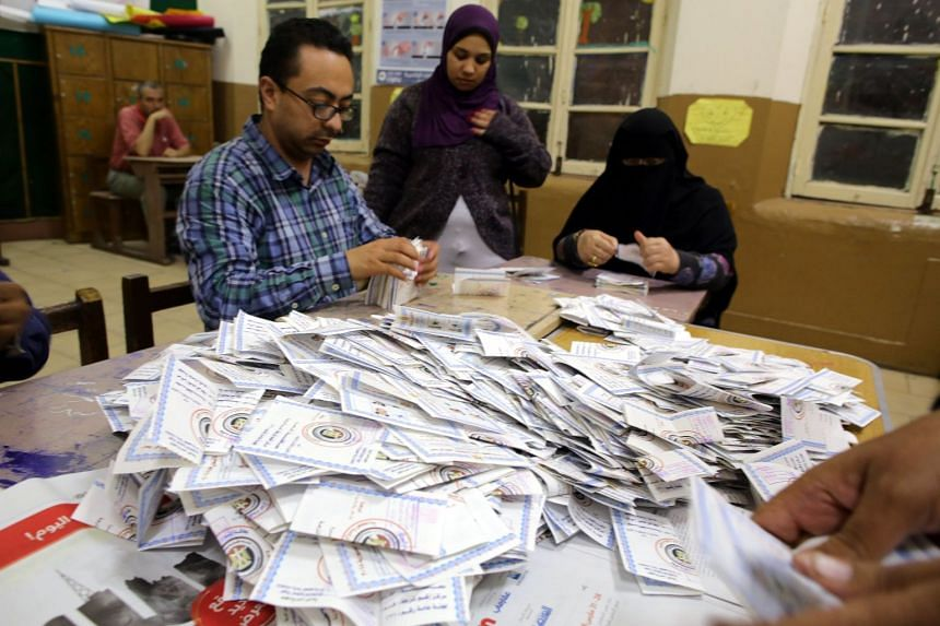 Electoral workers count ballots at the end of the final day of the Egyptian presidential election in Cairo on 28 March 2018.