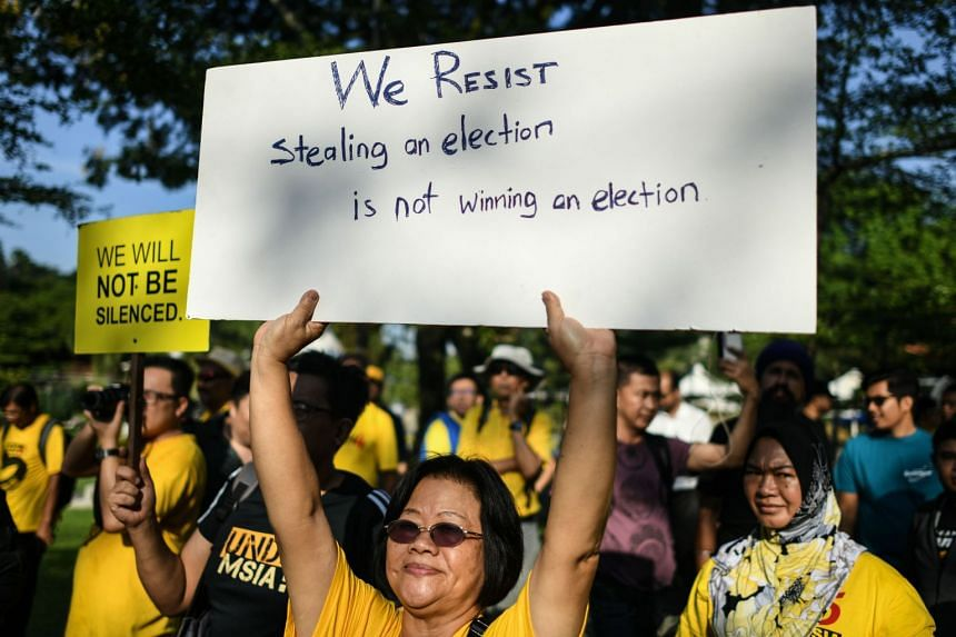 People protest at a rally organised by election reform group Bersih against a bill to redraw electoral boundaries near Parliament House in Kuala Lumpur on March 28, 2018.