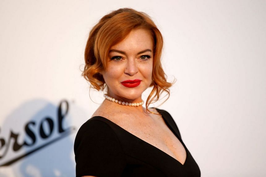 Lindsay Lohan posing at an event in France in May 2017.