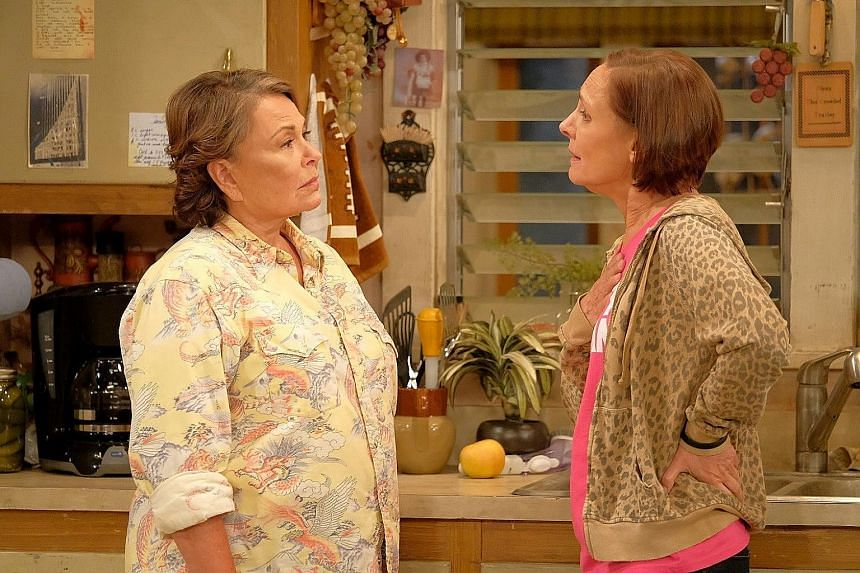 Roseanne Barr (far left) and Laurie Metcalf in the Roseanne reboot, which premiered to encouraging ratings.