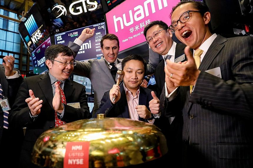 Huami Corporation chief executive Wang Huang ringing a ceremonial bell to celebrate his company's IPO at the New York Stock Exchange last month.
