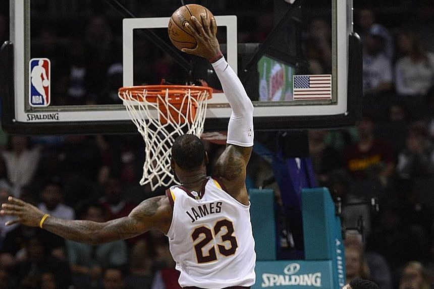 LeBron James dunking the ball on the way to 41 points at Charlotte's Spectrum Centre. That makes it the 866th straight game the Cleveland star has scored at least 10 points, a record he shares with Michael Jordan.