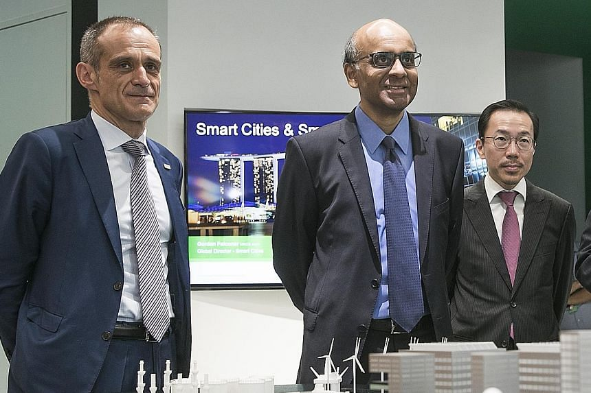 From left: Schneider Electric's chairman and chief executive Jean-Pascal Tricoire, Deputy Prime Minister Tharman Shanmugaratnam and Economic Development Board chairman Beh Swan Gin at the firm's East Asia and Japan headquarters (below) in Kallang, wh