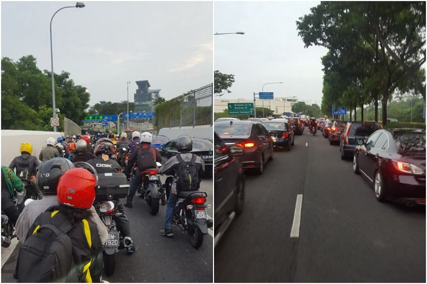 Several photos posted on Facebook show a long, snaking queue of vehicles towards the Woodlands checkpoint.