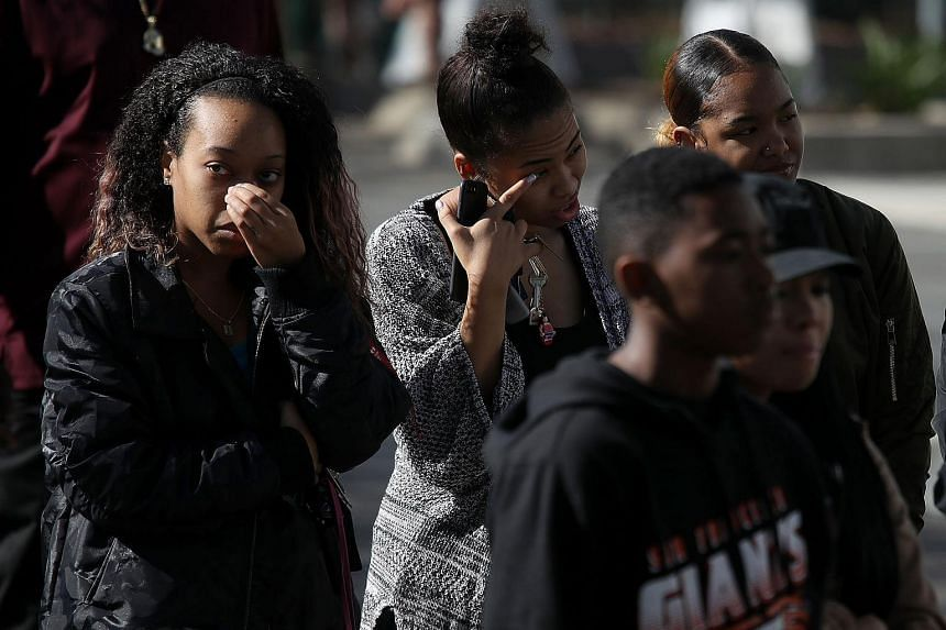 Mourners stand in line to enter the funeral services for Stephon Clark at the Bayside Boss Church in Sacramento, California, on March 29, 2018.