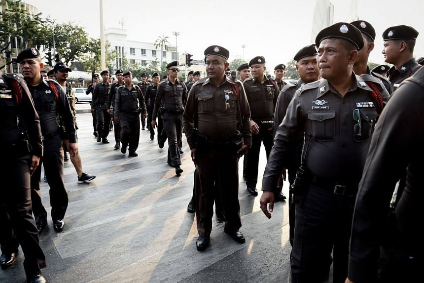 Thai police gather on the streets to monitor anti-junta protests in Bangkok on Feb 10, 2018.