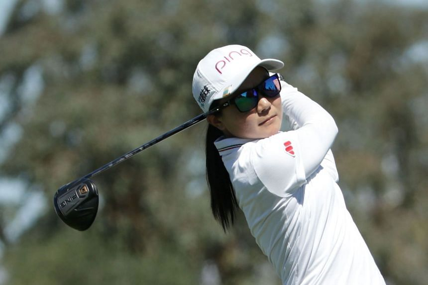 Ayako Uehara of Japan plays her tee shot on the ninth hole during the first round.
