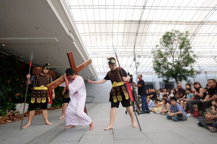 Roman soldiers abusing Jesus during the Passion play at Novena Church, known officially as the Church of St Alphonsus, on March 30, 2018.