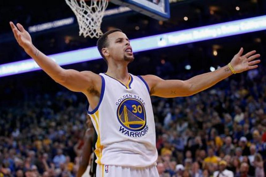 Stephen Curry of the Golden State Warriors reacts towards the crowd during their game against the Milwaukee Bucks at ORACLE Arena on Dec 18, 2015.