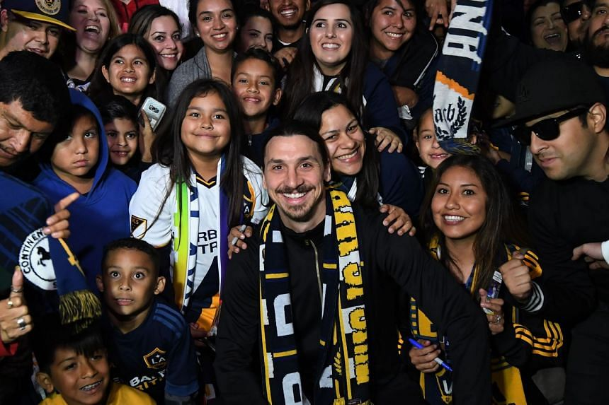 Ibrahimovic is greeted by fans after arriving at Los Angeles International Airport to begin his new LA Galaxy contract.