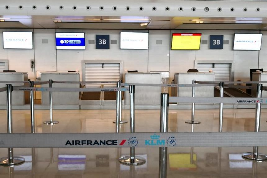 Empty Air France check-in desks are seen in Charles de Gaulle airport in Roissy, outside Paris, during a national Air France strike on March 23, 2018.