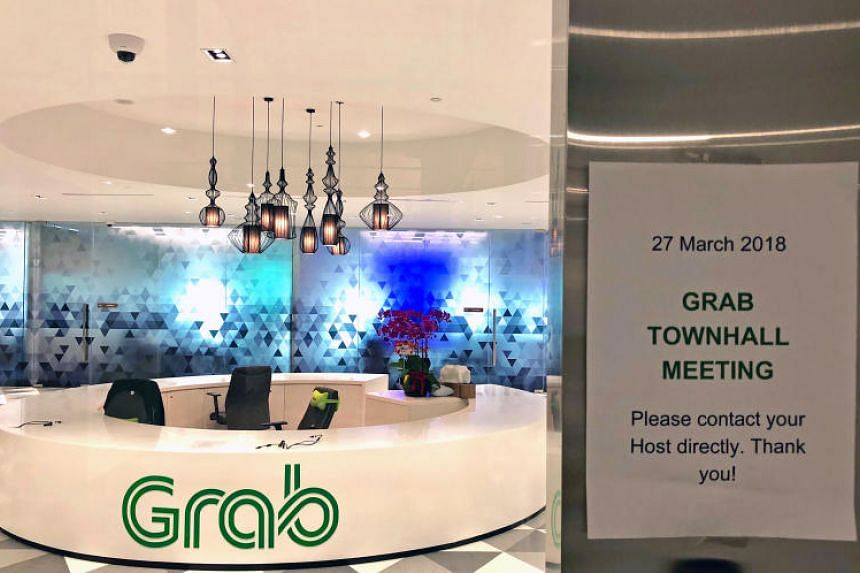 A notice announcing a townhall meeting is seen outside the Grab office at Marina One West Tower on March 27, 2018.