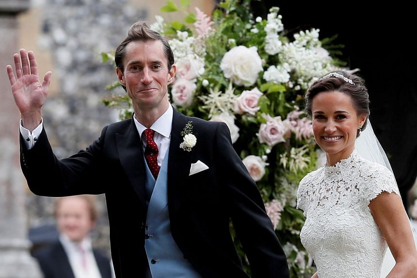 Pippa Middleton and husband James Matthews smile following their wedding ceremony in 2017.