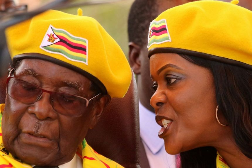 Mugabe listens to wife Grace at a rally for the Zanu-PF party in November 2017.