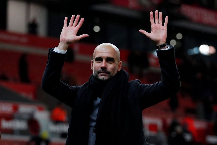 Manchester City manager Pep Guardiola gestures after a match.