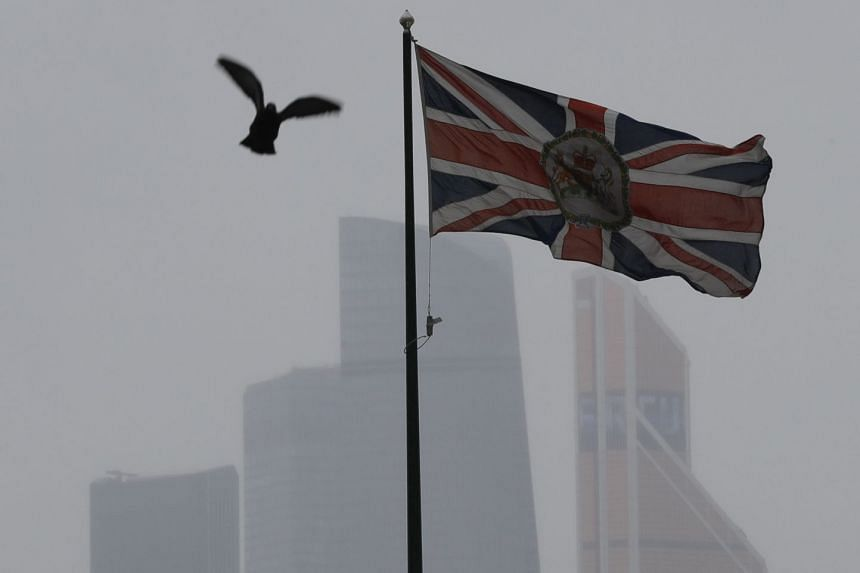 The British flag flies over the embassy building in Moscow. Britain was given a month to reduce the number of their diplomatic staff to the same number Russia has in Britain.