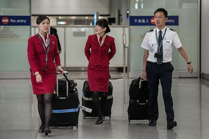 Many of Cathay Pacific's female flight attendants have expressed concern over wearing short skirts while working.