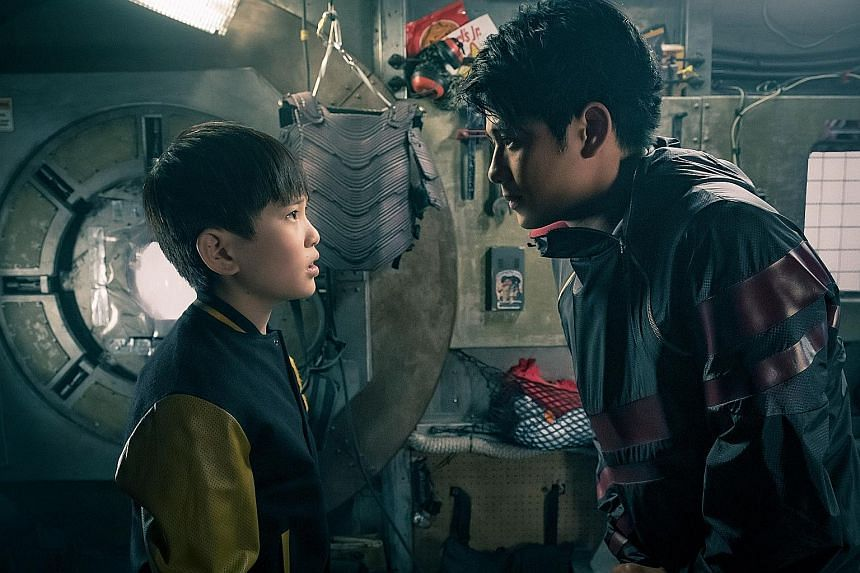 Steven Spielberg (far left) with Ready Player One author Ernest Cline. Tye Sheridan's character Wade Watts (left) watches as Olivia Cooke's Art3mis prepares to enter the world of virtual reality. Asian Hollywood newcomers Philip Zhao (left) and Win M