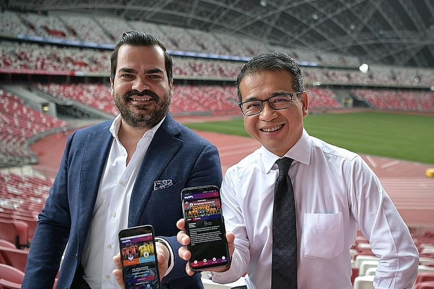 FAS vice-president Edwin Tong and Converzion chief executive James Nicol showing off the mySPL web application. The Singapore Premier League's digital push is a key part of the league's rebranding.
