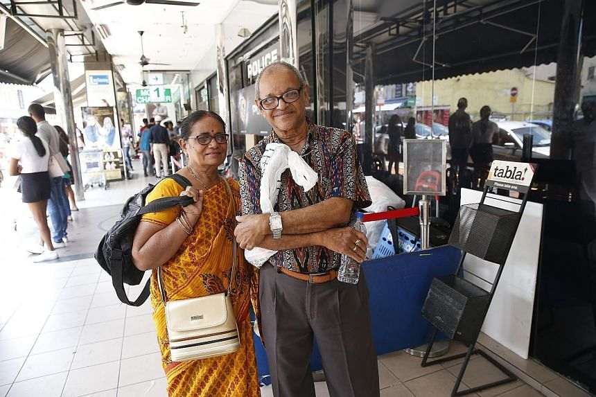 Dr Ram Mohan Panda and his wife, Dr Shail Bala Panda, outside Mustafa Centre last week. It was their first trip to Singapore. Indian tourists are now the third-largest group of visitors to the Republic.