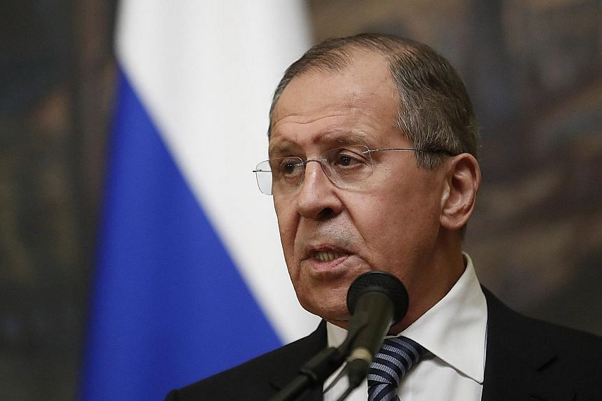 Above: Russian Foreign Minister Sergei Lavrov said the measures against the US include expelling the same number of diplomats as those ordered out by Washington. Left: Russia is also closing the US Consulate in St Petersburg.