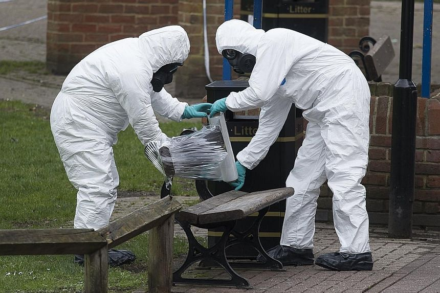 Army personnel removing the bench in the English town of Salisbury where former Russian spy Sergei Skripal and his daughter were found earlier this month. Britain claims the Novichok-5 nerve agent - said to have been developed by the late Russian gen