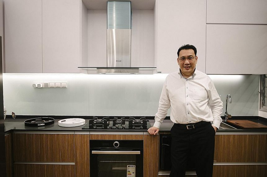 This showflat (above) in Gain City's Sungei Kadut store is the same size as a five-room Housing Board flat, says managing director Kenny Teo (below).